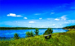 Bench on river shore in nature countryside
