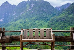 bench on the balcony with mountain and forest after rain at Chiang Dao, Chiang Mai, Thailand