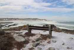Bench on the beach of the small coastal town Yzerfontein. By the wild Atlantic Ocean, on the west coast of South Africa.