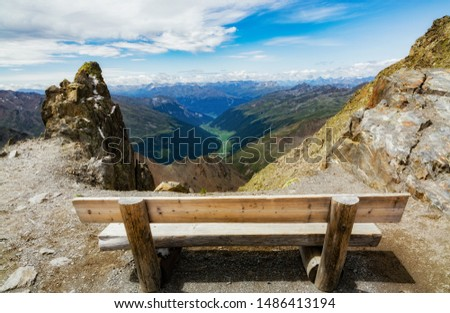 Bench on the top of Karlesjoch (austrian Alps) in the Kaunertal glacier. Landscape toward the Italian alps and the swiss alps. #1486413194