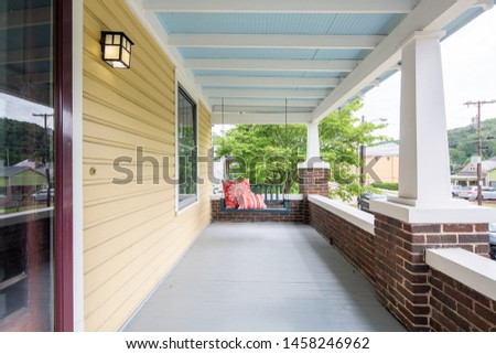 Bench Swing on front porch, Yellow walls and blue ceiling, front patio with swinging chair