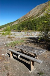 Bench, table and mountainside. Altay. Russia.