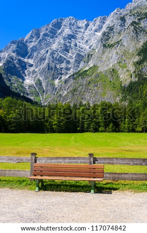 Bench wooden fence mountain view path way, Berchtesgaden National Park, Germany