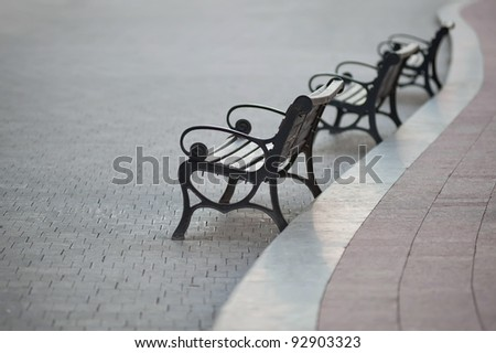 benches perspective on the curve