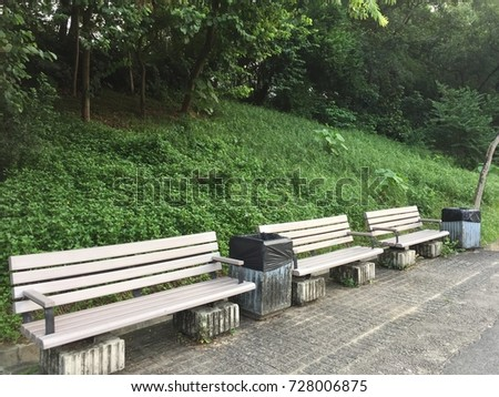 benches with dusbins in a park