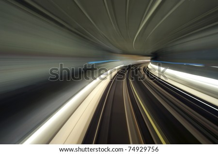 Bend in a subway tunnel, seen from the cockpit using a long exposure