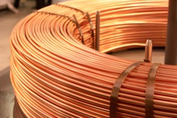 Bended fat curved copper cables. Electrical conductor.