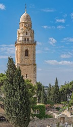 Benedictine Dormition Abbey bell tower. Ancient buildings around the Old City in Jerusalem, Israel. The Old City, Jerusalem's historic Center. Ancient architecture Travel photo. Vertical Panorama