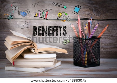 Benefits, Business Concept. Stack of books and pencils on the wooden table. #548983075