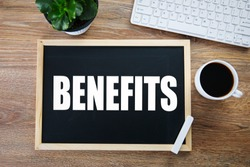 benefits text on board with keyboard