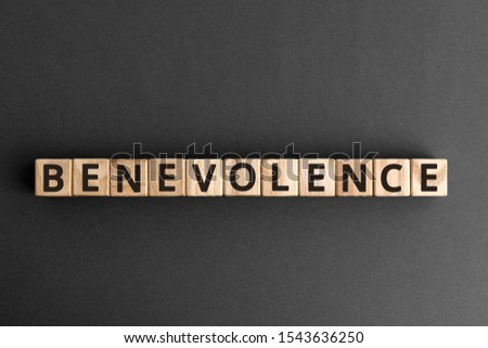 Benevolence - word from wooden blocks with letters, being kind and helpful benevolence concept,  top view on grey background Stock photo ©