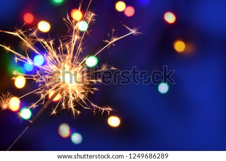 Bengal light in new year night. Celebration silvester  fun background #1249686289