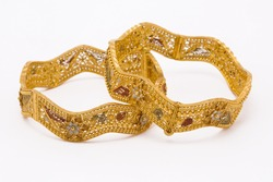 Bengali traditional wedding gold bangles for women in white background.