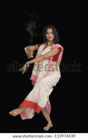 Bengali woman performing ritual dance