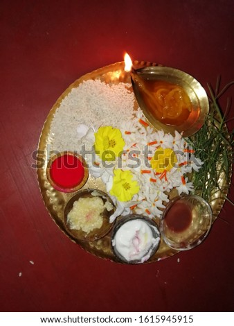 Bengali  worship thali. Indian people arrange some flower, some grass called durba and light lamp before any worship