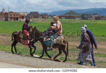 BENI MELLAL, MOROCCO - APRIL 16: Berber family riding on donkeys, April 16 2010 in Beni Mellal near Marrakesch in the Atlas Mountains, Morocco.