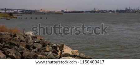 Benicia harbor from the shore #1150400417