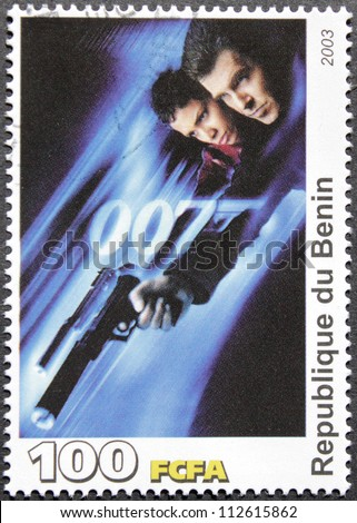 "BENIN - CIRCA 2003: A postage stamp printed by Benin shows American actress Halle Berry and Irish actor Pierce Brosnan starring in the film ""Die Another Day"", circa 2003 - stock photo"