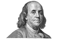 Benjamin Franklin cut from new 100 dollars banknote  on white background fragment