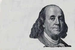 Benjamin Franklin cut on old 100 dollars banknote isolated on white background