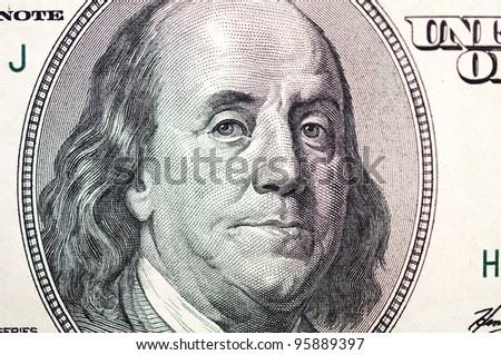 Benjamin Franklin face on dollar bill - stock photo