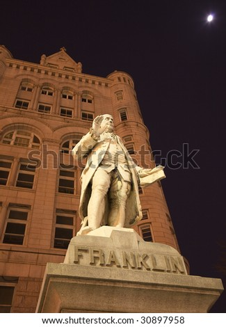 Benjamin Franklin Statue Old Post Office Building Pennsylvania Ave Washington DC with moon in the background