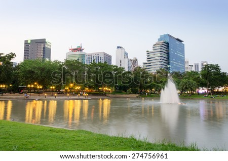 Benjasiri Park with many modern condominiums and business building on the Sukhumvit road in Bangkok, Thailand.