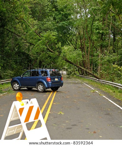 BENSALEM, PA - AUGUST 28: State Road is closed by several fallen trees over the roadway following Hurricane Irene August 28, 2011 in Bensalem, PA. A truck turns around in the foreground.