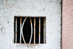 bent jail bars after a prison break.