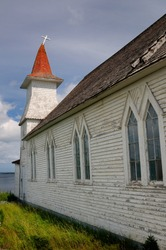 Bent steeple with cross of Anglican Christ Church at Clarke's Head Gander Bay Newfoundland