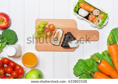 Bento box with different food, fresh veggies and fruits #633803108