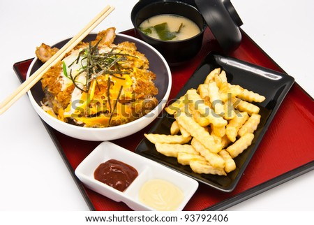 Bento, Japanese food style , fried chicken and  rice and soup and French fries on white background