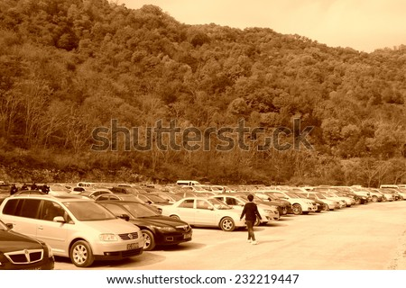 BENXI - OCTOBER 4: Many cars parked in parking of a scenic spot on October 4, 2013, Benxi city, Liaoning province, China