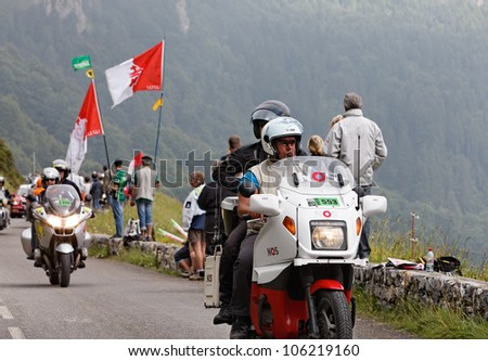 BEOST,FRANCE-JUL 15:Official motorbike passing before the arrival of the peloton on the category H mountain pass Aubisque, during the 13th stage of Le Tour de France  on July 15 2011 in Beost France.