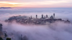 Bergamo Città Alta shrouded in fog on a foggy winter morning, this is the oldest part of medieval Bergamo, Lombardy, Italy.