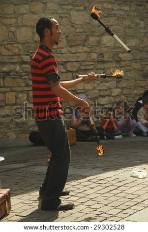 BERGAMO, ITALY - APRIL 25 : Street performer performs his act at 9° international festival of art on the street April 25, 2009 in Bergamo, Italy.