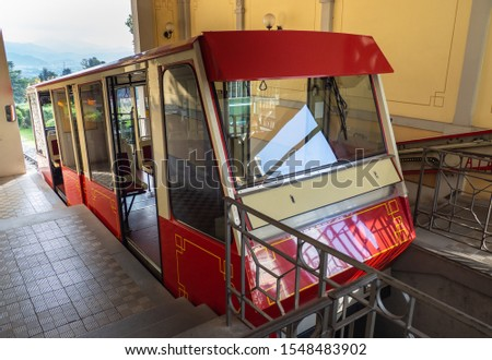 Bergamo, Italy. October 30, 2019. The red funicular at the upper station of San Vigilio. It is a cable car that connects the old town to the highest neighborhood in the city #1548483902