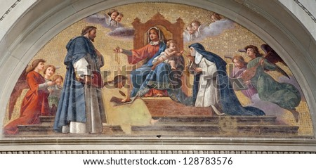 BERGAMO - JANUARY 29: Madonna with the child and holy John from the cross and Theresia of Avila from portal of st. Stephen and st.Bartholomew church on January 29, 2013 in Bergamo, Italy.