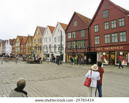 BERGEN, NORWAY – AUGUST 11: Visitors and locals enjoy watching historic buildings along the Bryggen Wharf on August 11, 2005 in the Hansa District of Bergen.