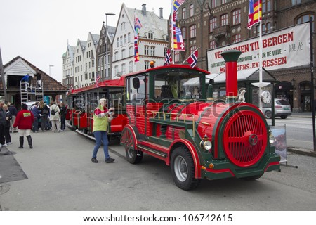 BERGEN, NORWAY - MAY 8: A road train in Bergen, Norway, on  May 8, 2012. The driver and some passengers wait to depart on a tour of the city from the UNESCO World Heritage Site, Bryggen.