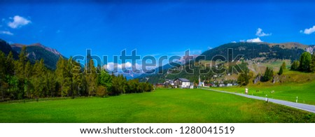 Bergun Super-wide Panorama: This unspoiled Swiss alpine village lies at the gateway to the Engadine valley. The deep blue sky & lush green meadows complete this pic.