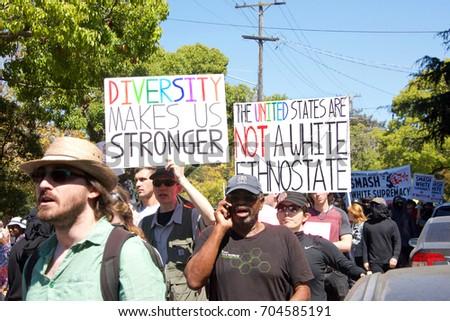 Berkeley, CA - August 27, 2017: Unidentified participants at the NO TO MARXISM IN AMERICA rally in Martin Luther King Jr. Civic Center Park, more counter-protesters than protesters. #704585191