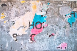 Berlin abstract artistic concrete weathered city building wall with ripped torn street posters