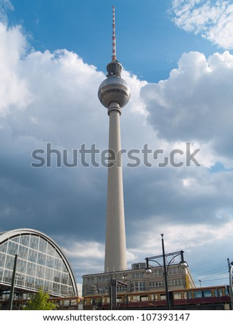 Berlin, Alexanderplatz train station with train on bridge and TV tower