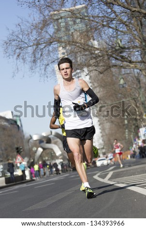 BERLIN - APRIL 7: Participants  of the thirty-third  half marathon at km 14, 2013  in Berlin, Germany.
