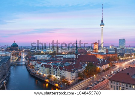 Berlin at night with TV tower and Alexanderplatz on the Spree at the Berlin Cathedral