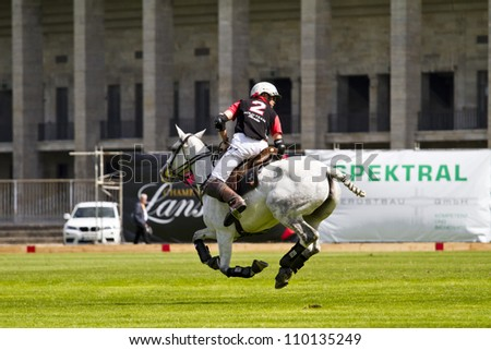 "BERLIN- AUGUST 12- Unidentified Polo player in fast action at ""Berlin Polo Cup"" competition  August 12, 2012 in Berlin, Germany."
