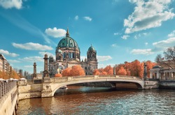 Berlin Cathedral with a bridge over Spree river in Autumn, toned image