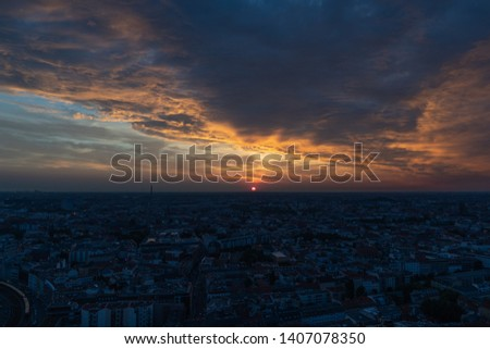 Berlin cityscape at sunset during a cloudy sky