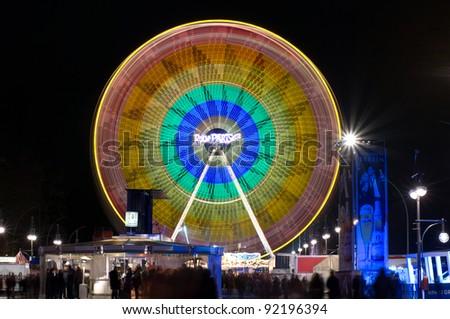 BERLIN - DECEMBER 30: Ferris Wheel at night illumination. Street 17 June. Christmas Market, on December 30, 2011 in Berlin, Germany. The 17 June Street is a street in central Berlin